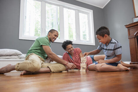family-on-the-floor-playing-a-game-at-home-JCS7XG3